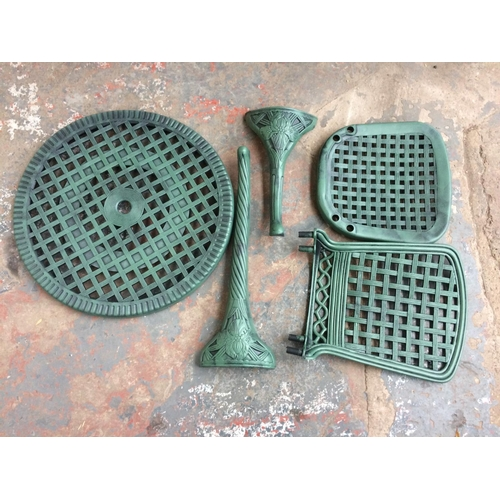 19 - A BOXED GREEN PLASTIC PATIO SET...