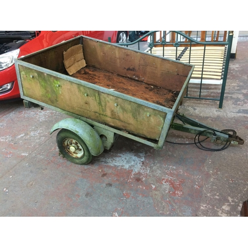 29 - A TWO WHEELED GALVANISED METAL AND WOOD CAR TRAILER MEASURING APPROX 4'6