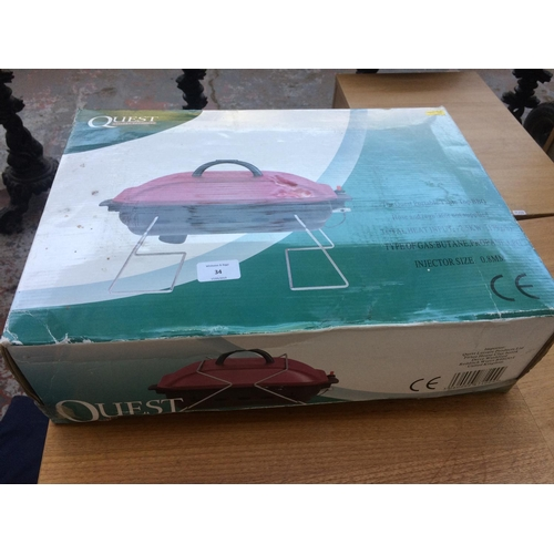 34 - A BOXED QUEST PORTABLE TABLE TOP BARBECUE...