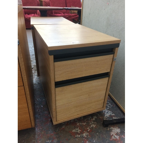36 - TWO WOOD EFFECT TWO DRAWER OFFICE FILING CABINETS...