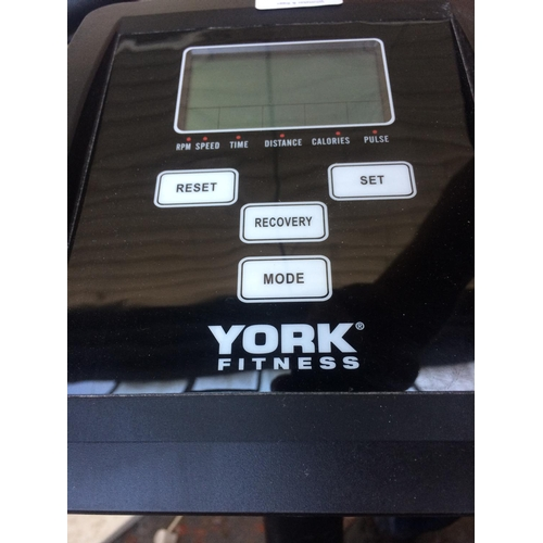 38 - A BLACK YORK FITNESS QUEST EXERCISE BIKE WITH DIGITAL READOUT (W/O)...