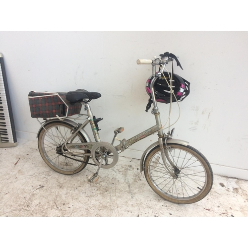 4 - A GREY RALEIGH PLAZA FOLDING SHOPPING BIKE WITH REAR CARRIER, GEL SADDLE AND THREE SPEED STURMEY ARC...