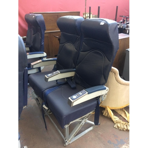 53 - A PAIR OF BLUE LEATHER AIRCRAFT SEATS ON METAL SUPPORTS...