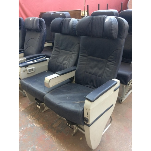 54 - A PAIR OF HEAVYWEIGHT BLUE LEATHER AIRCRAFT SEATS ON METAL SUPPORTS...