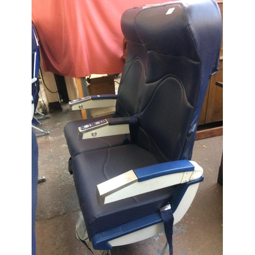 55 - A PAIR OF BLUE LEATHER AIRCRAFT SEATS ON METAL SUPPORTS...
