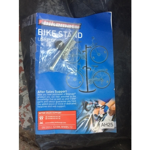 12 - A BAGGED BIKEMATE BLACK METAL BICYCLE STAND WITH INSTRUCTION MANUAL...