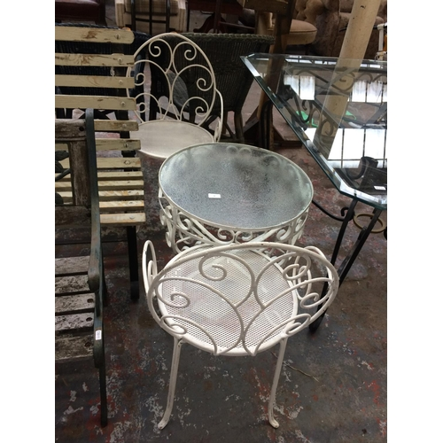 34 - A WHITE PAINTED THREE PIECE CONSERVATORY SET COMPRISING ORNATE CIRCULAR GLASS TOPPED TABLE AND TWO M...