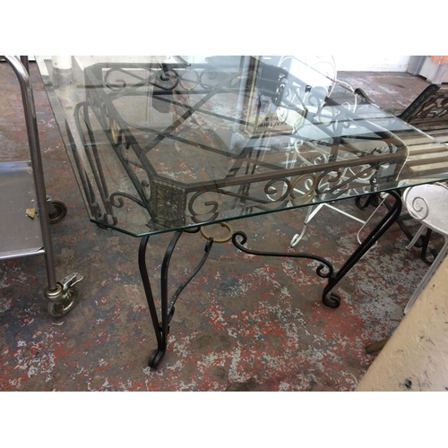 35 - A LARGE CUT GLASS SQUARE TOPPED CONSERVATORY TABLE ON ORNATE METAL SUPPORTS MEASURING APPROX 45