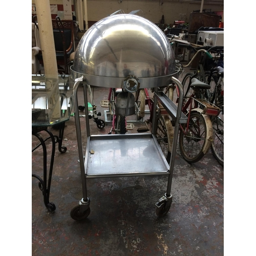 36 - A GOOD QUALITY STAINLESS STEEL CIRCULAR PROFESSIONAL CATERING CARVERY TROLLEY WITH DOMED LID...