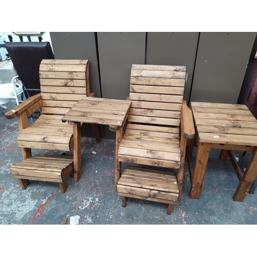 20 - A GOOD QUALITY SIX PIECE PINE PATIO SET COMPRISING TWO CHAIRS WITH CENTRAL TABLE, FOOT STOOLS AND TA...