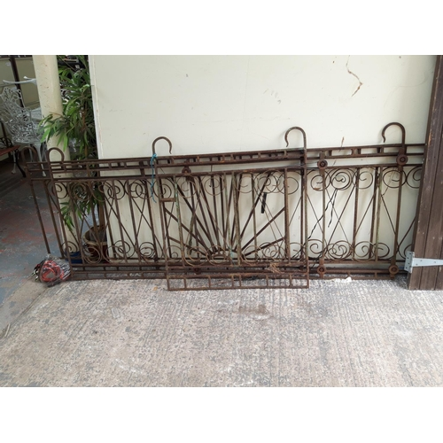 27 - A THREE PIECE METAL ORNATE DRIVEWAY GATE SET, ONE MEASURING APPROX 39