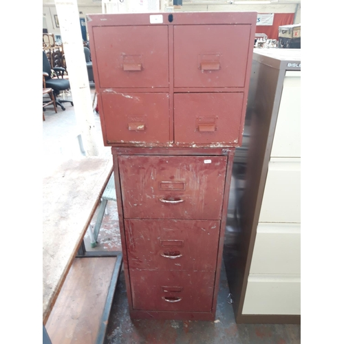 30 - TWO RED PAINTED METAL FILING CABINETS, ONE FOUR DRAWER AND ONE BISLEY THREE DRAWER...