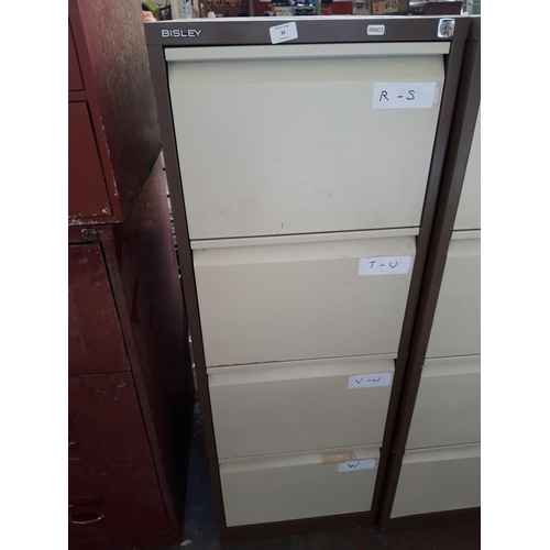 32 - A BROWN AND CREAM BISLEY FOUR DRAWER METAL OFFICE FILING CABINET WITH KEY...
