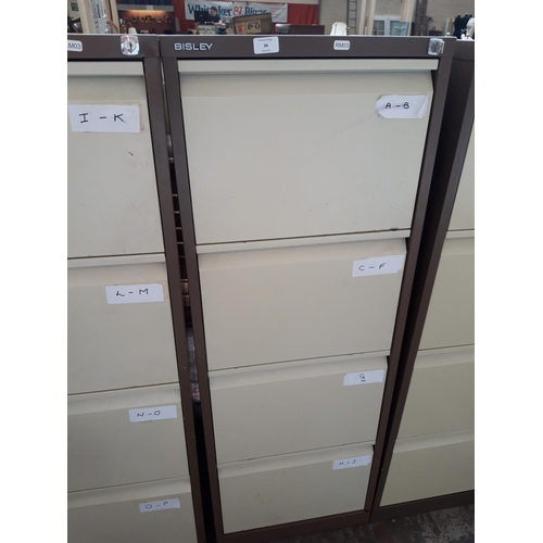 34 - A BROWN AND CREAM BISLEY FOUR DRAWER METAL OFFICE FILING CABINET WITH KEY...