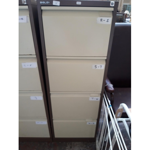 35 - A BROWN AND CREAM BISLEY FOUR DRAWER METAL OFFICE FILING CABINET...