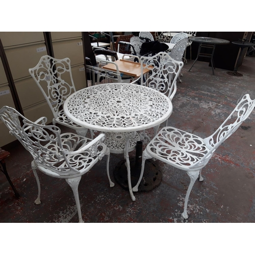 36 - SIX ITEMS TO INCLUDE A GOOD QUALITY CAST ALUMINIUM ORNATE PATIO SET COMPRISING CIRCULAR TABLE, TWO C...