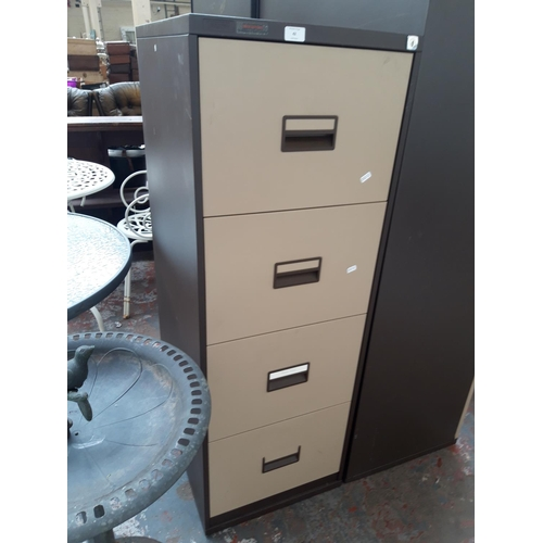 42 - A BROWN AND CREAM TRIUMPH FOUR DRAWER METAL OFFICE FILING CABINET...