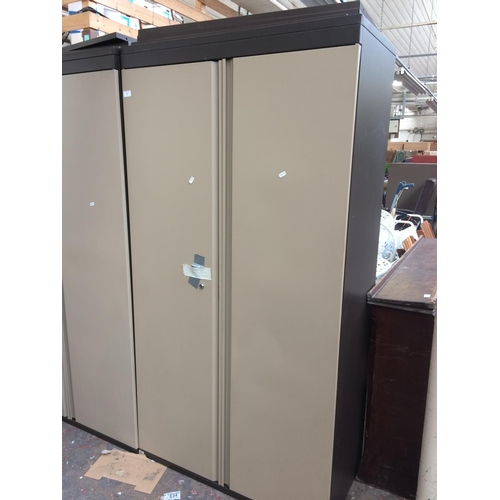 43 - A LARGE BROWN AND CREAM TRIUMPH OFFICE STORAGE CABINET...