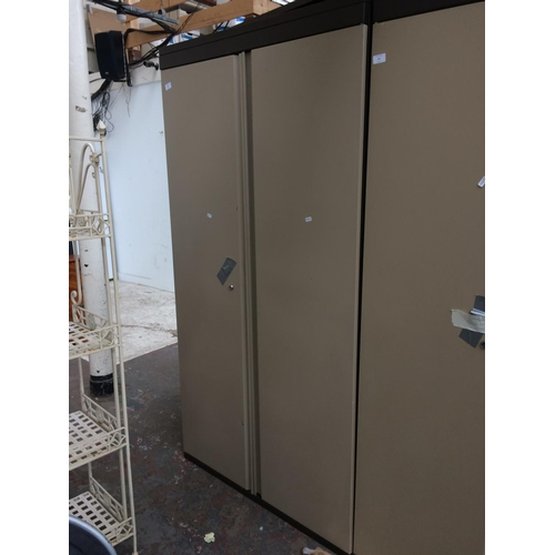 44 - A LARGE BROWN AND CREAM TRIUMPH OFFICE STORAGE CABINET...
