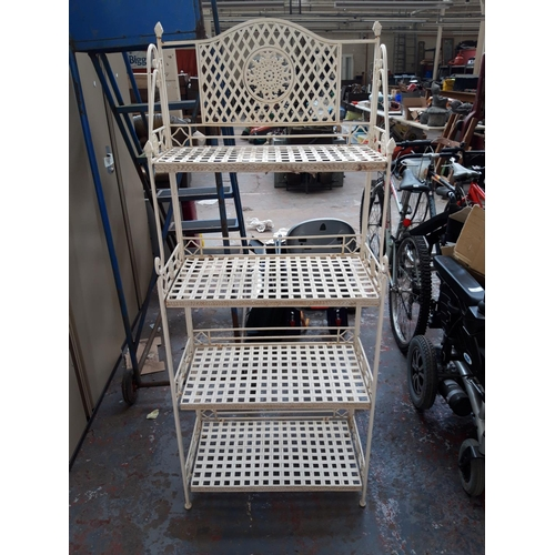 45 - A WHITE PAINTED ORNATE FOUR SHELF PLANT STAND...