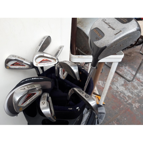 52 - A BLACK MAX FLY GOLF BAG CONTAINING DONNAY AND GOLF GEAR GOLF CLUBS...