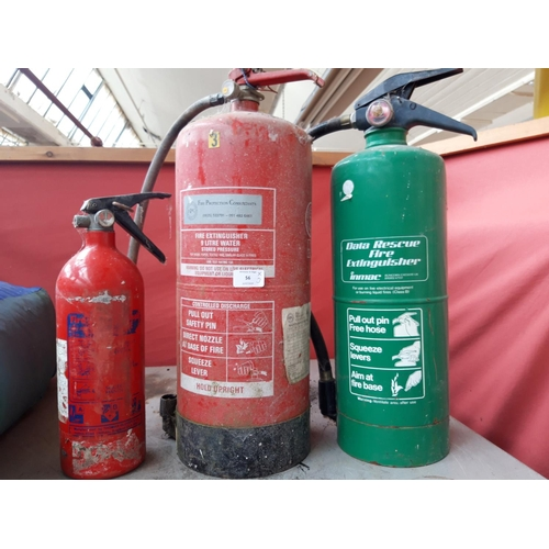56 - THREE FIRE EXTINGUISHERS, ONE 9 LITRE WATER, ONE 7 KILO ELECTRICAL AND ONE OTHER...