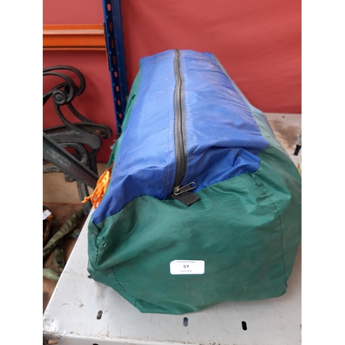 57 - A BAGGED TENT...