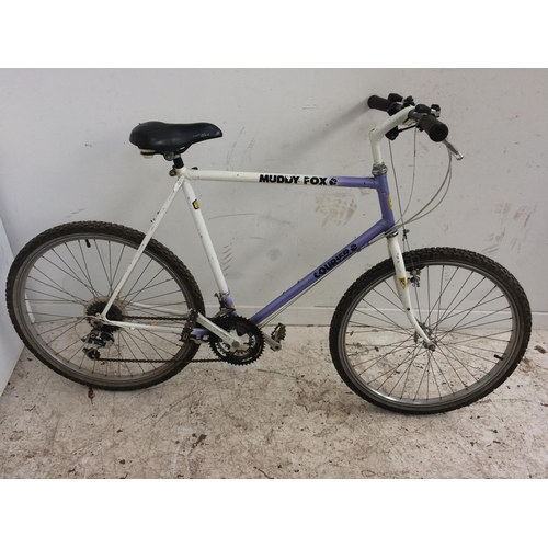 9 - A PURPLE AND WHITE MUDDY FOX COURIER GENTS MOUNTAIN BIKE WITH QUICK RELEASE FRONT WHEEL  AND 18 SPEE...
