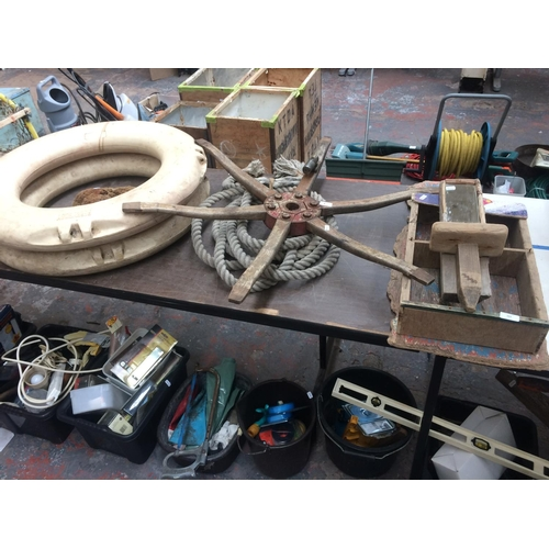 107 - A COLLECTION OF MARITIME EQUIPMENT TO INCLUDE TWO PERRY BUOY SAFETY RINGS, LENGTH OF ROPE, SPONGE, A...