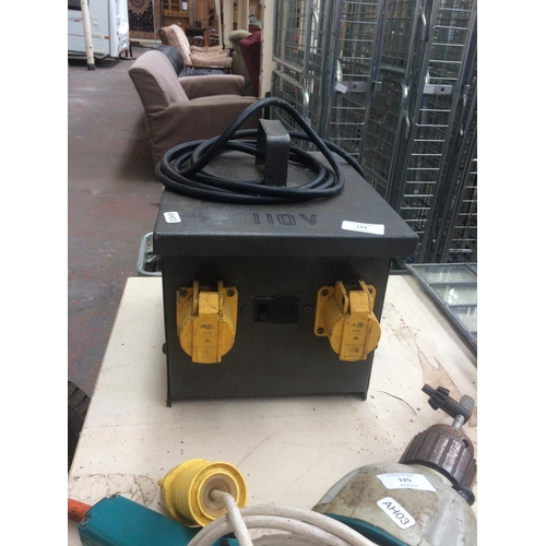 124 - A LARGE INDUSTRIAL TWIN SOCKET 110V TRANSFORMER AND A LARGE HEAVY DUTY 110V ELECTRIC DRILL...