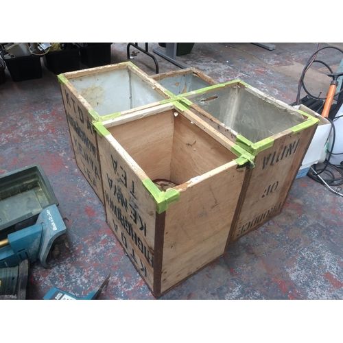 129 - FOUR WOODEN TEA CHESTS...