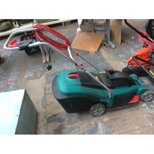 132 - A GREEN BOSCH ELECTRIC LAWN MOWER WITH GRASS COLLECTOR...