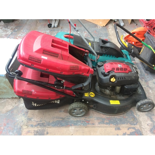 133 - A RED AND BLACK MOUNTFIELD RM55 PETROL LAWN MOWER WITH TWO GRASS COLLECTORS...