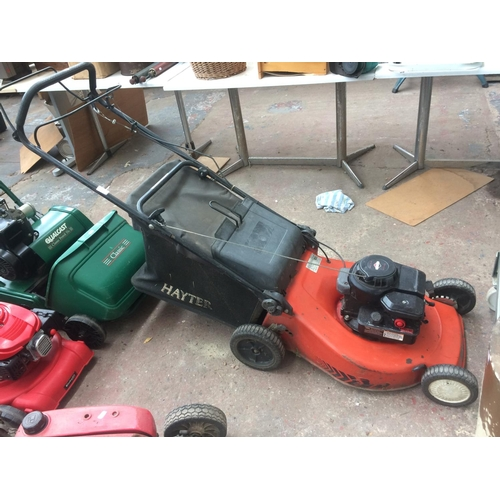 138 - A BLACK AND RED HAYTER PETROL LAWN MOWER WITH BRIGGS & STRATTON ENGINE AND GRASS COLLECTOR...