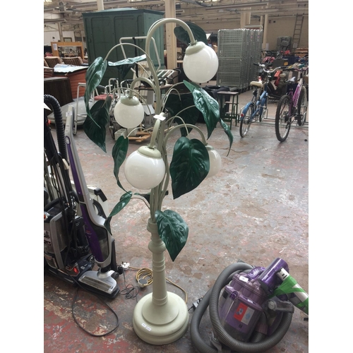 163 - AN UNUSUAL GREEN PAINTED METAL LAMP WITH LEAF DESIGN AND FOUR GLASS SHADES W/O...