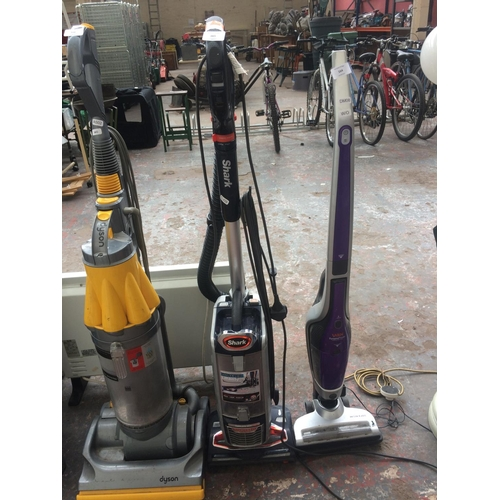 165 - A BLUE AND GREY SHARK LIFTAWAY UPRIGHT VACUUM CLEANER (W/O)...