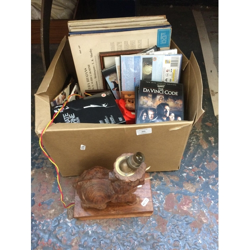 255 - A BOX CONTAINING MIXED ITEMS TO INCLUDE CARVED WOODEN ELEPHANT TABLE LAMP, LP RECORDS, DVDS ETC...