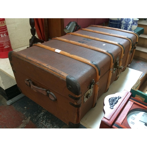 277 - A VINTAGE METAL BOUND TRAVEL TRUNK...