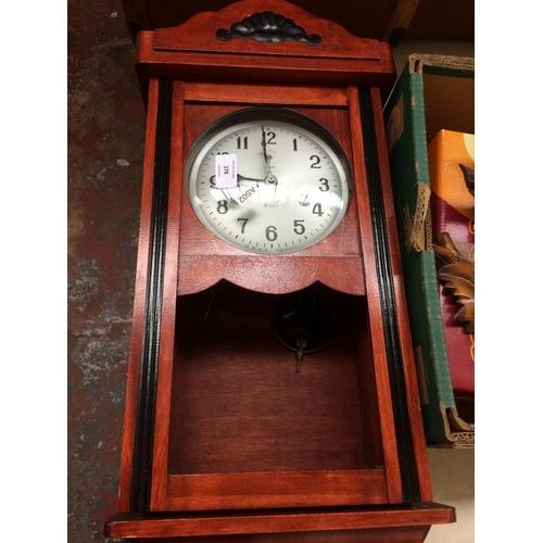 278 - TWO CLOCKS TO INCLUDE AN ORIGINAL SCHWARZWALD CUCKOO CLOCK AND A POLARIS 31 DAY MAHOGANY WALL CLOCK...