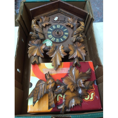 278 - TWO CLOCKS TO INCLUDE AN ORIGINAL SCHWARZWALD CUCKOO CLOCK AND A POLARIS 31 DAY MAHOGANY WALL CLOCK...