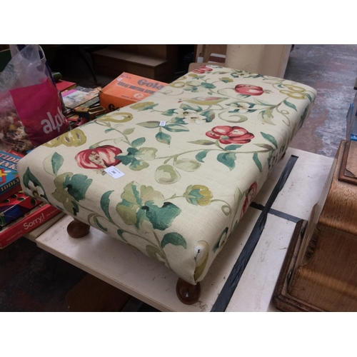 280 - A LARGE FLORAL UPHOLSTERED FOOTSTOOL ON CABRIOLE SUPPORTS...