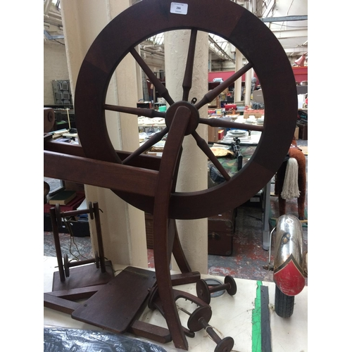 286 - A VINTAGE WOODEN SPINNING WHEEL...