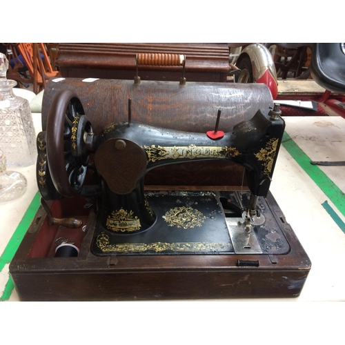 289 - A VINTAGE SINGER SEWING MACHINE WITH CASE...