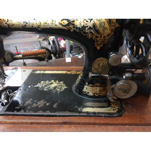 290 - A VINTAGE SINGER SEWING MACHINE WITH SQUARE CASE...