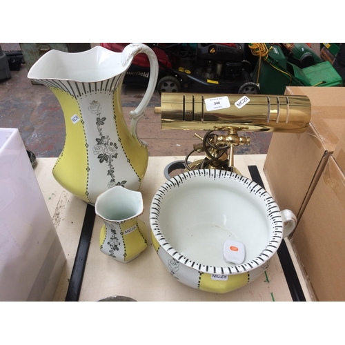 340 - A F WINKLE & CO THREE PIECE WATER SET AND A BRASS PIANO LAMP...
