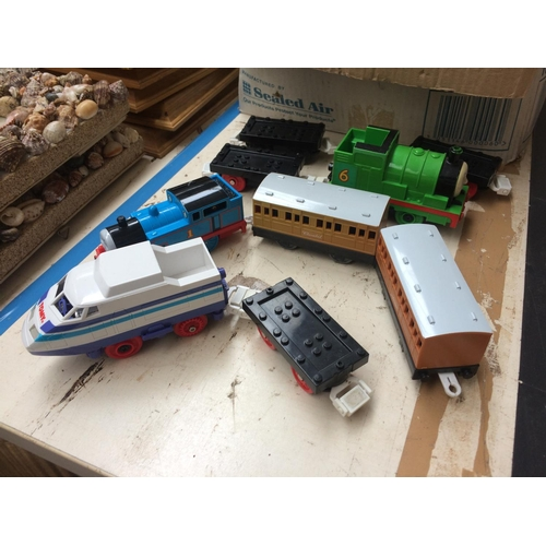 345 - A COLLECTION OF TOMY TOYS TO INCLUDE THOMAS THE TANK, TRACK, BUILDINGS, CARS ETC...