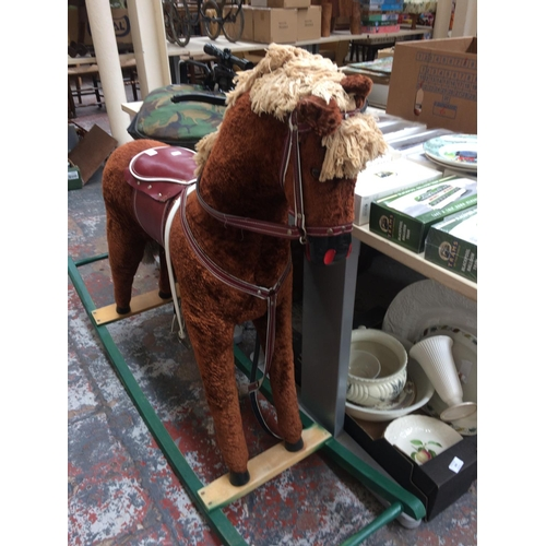 369 - A LARGE BROWN ROCKING HORSE ON WOODEN BASE...