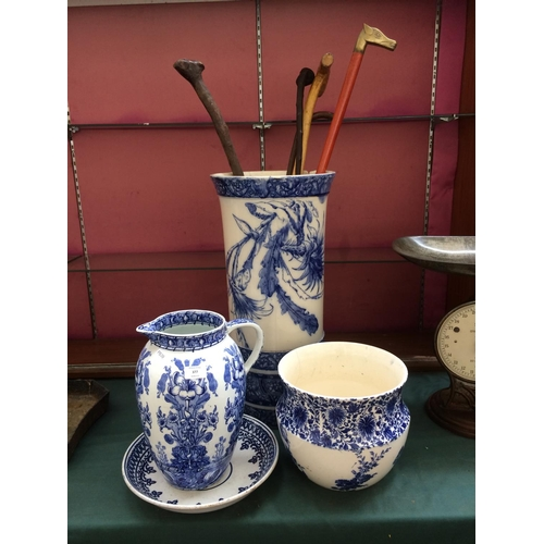 377 - FOUR ITEMS TO INCLUDE A VICTORIAN BLUE AND WHITE STICK STAND CONTAINING STICKS (A/F), A DOULTON BURS...