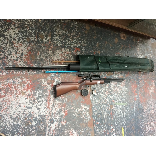 382 - A 1.77 AIR RIFLE WITH PELLETS AND A FISHING SPIN ROD AND BAG (RIFLE NEEDS ATTENTION)...