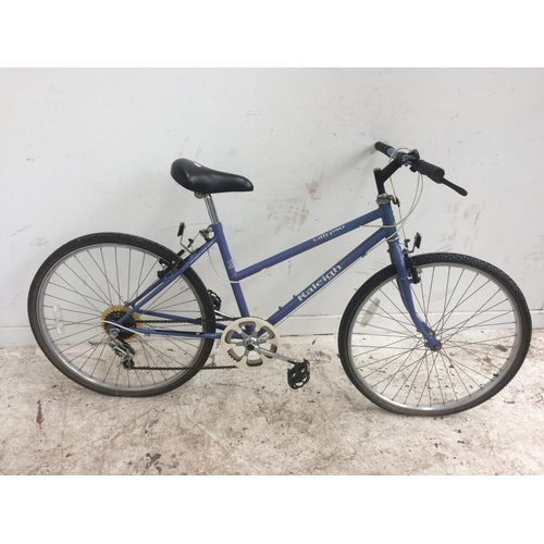 4 - A PURPLE RALEIGH CALYPSO GIRL'S MOUNTAIN BIKE WITH 5 SPEED SHIMANO GEAR SYSTEM...